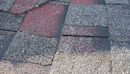 residential-damaged-shingles-cracking-and-worn